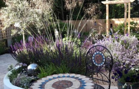 Sanctuary garden with Stipa gigantica,Salvia and Nepeta.